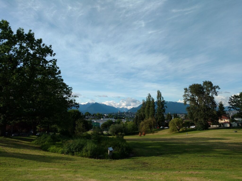 Falaise Park in spring with North Shore Mountains as backdrop