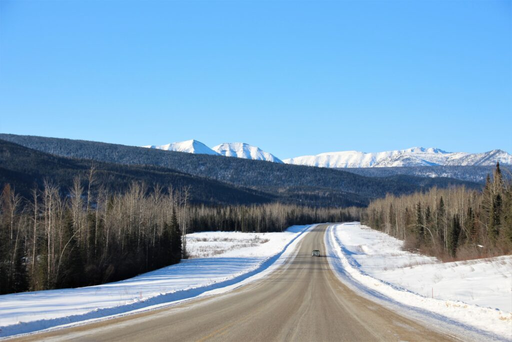 Alaska Highway with Northern Rockies in the distance