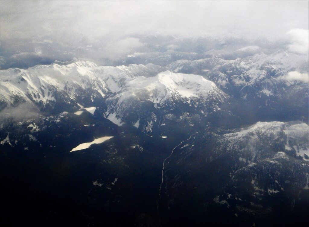 Aerial view of the coastal mountains with volcano mouth in the distance