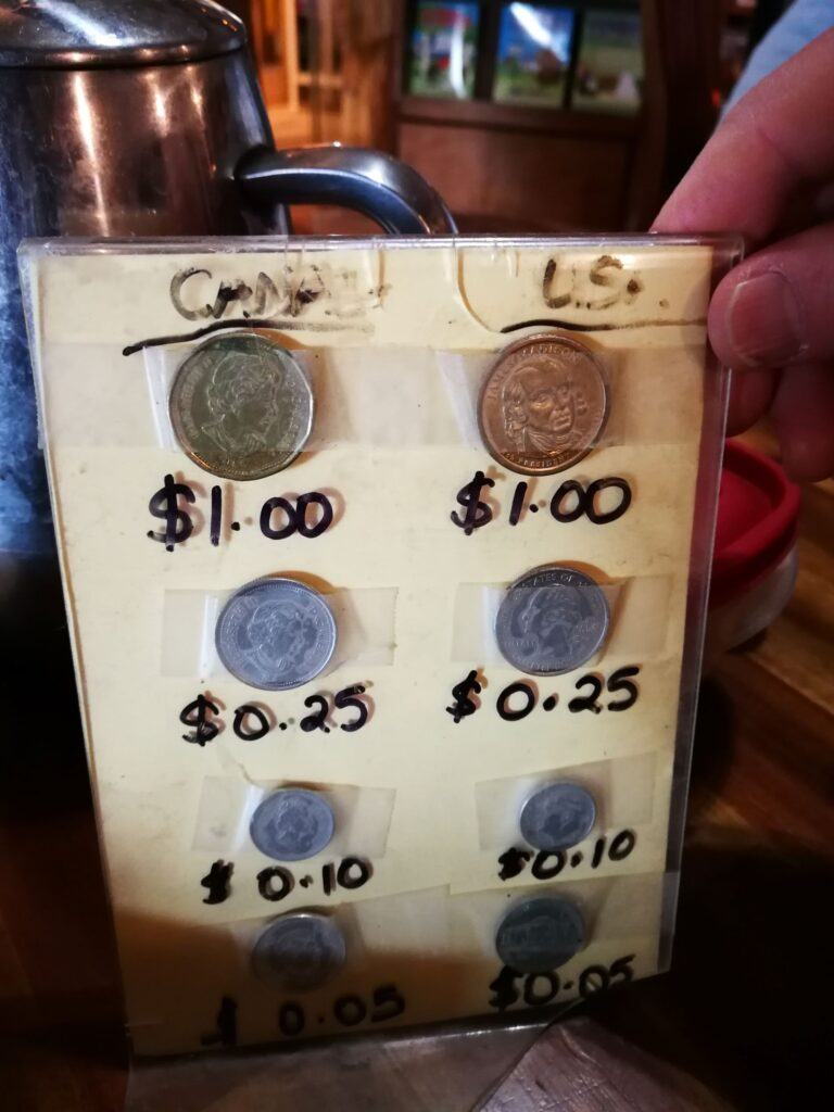 card with Canadian coins tapped on it