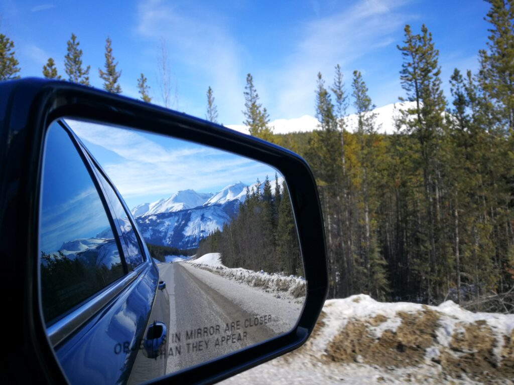 Northern Rockies reflection in the rear mirror