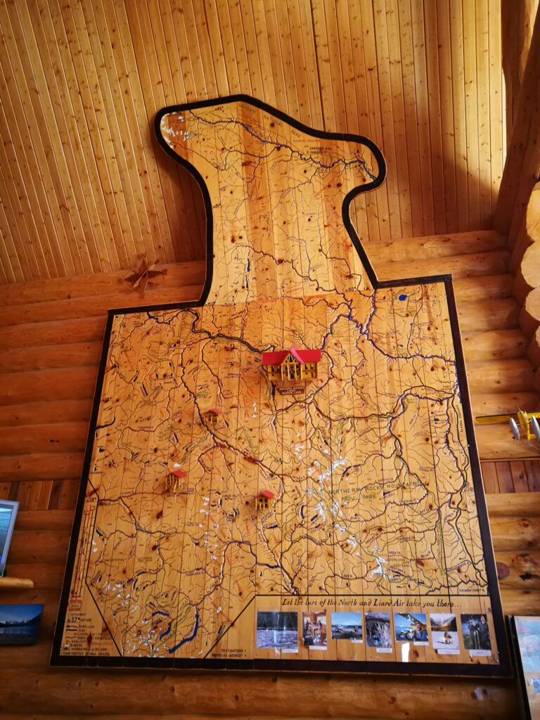 Huge map carved out of wood planks on the wall