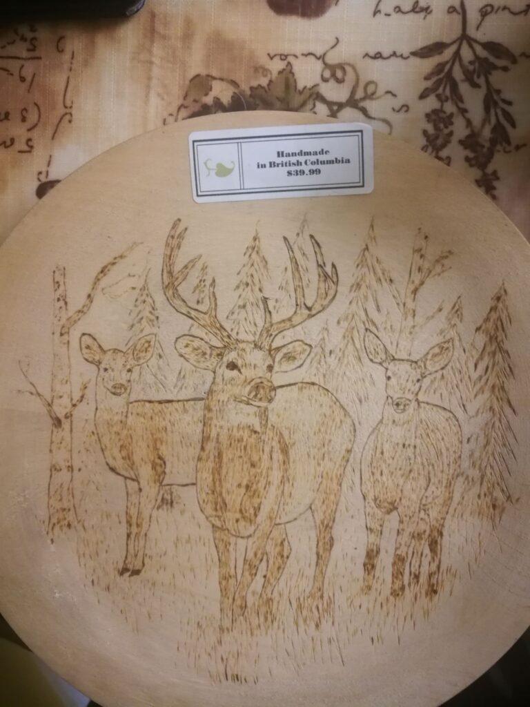 Pokerwork (Pyrography) on birch plate of caribous by E. Meatzen