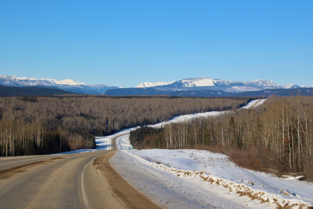 Alaska Highway stretching towards the mountains in the distance