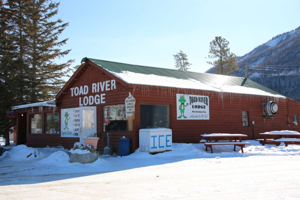 Toad River Lodge with gas pumps restaurant post office and gift shop at historic Mile 422