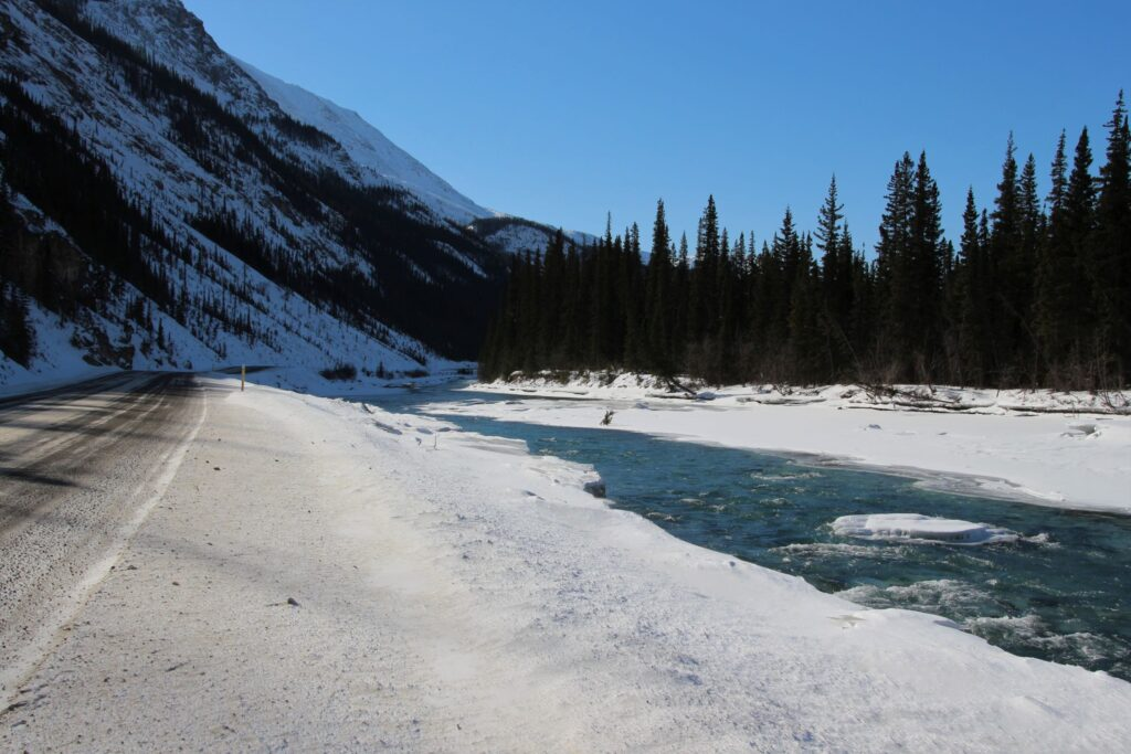 Toad River to the right with ice starting to melt