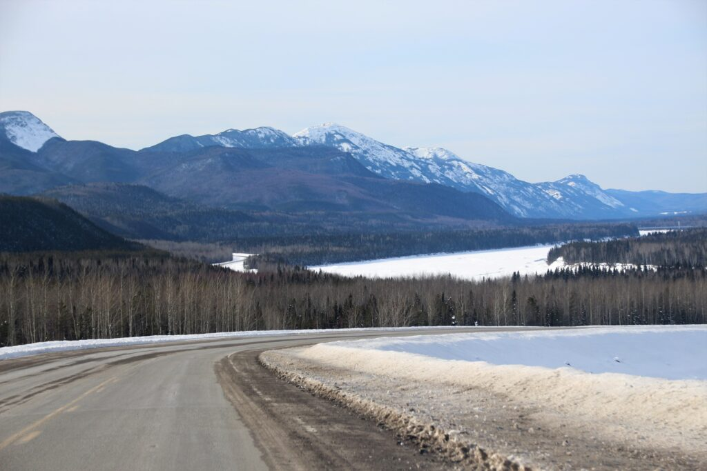 Muncho Lake covered by snow viewable from Alaska Highway