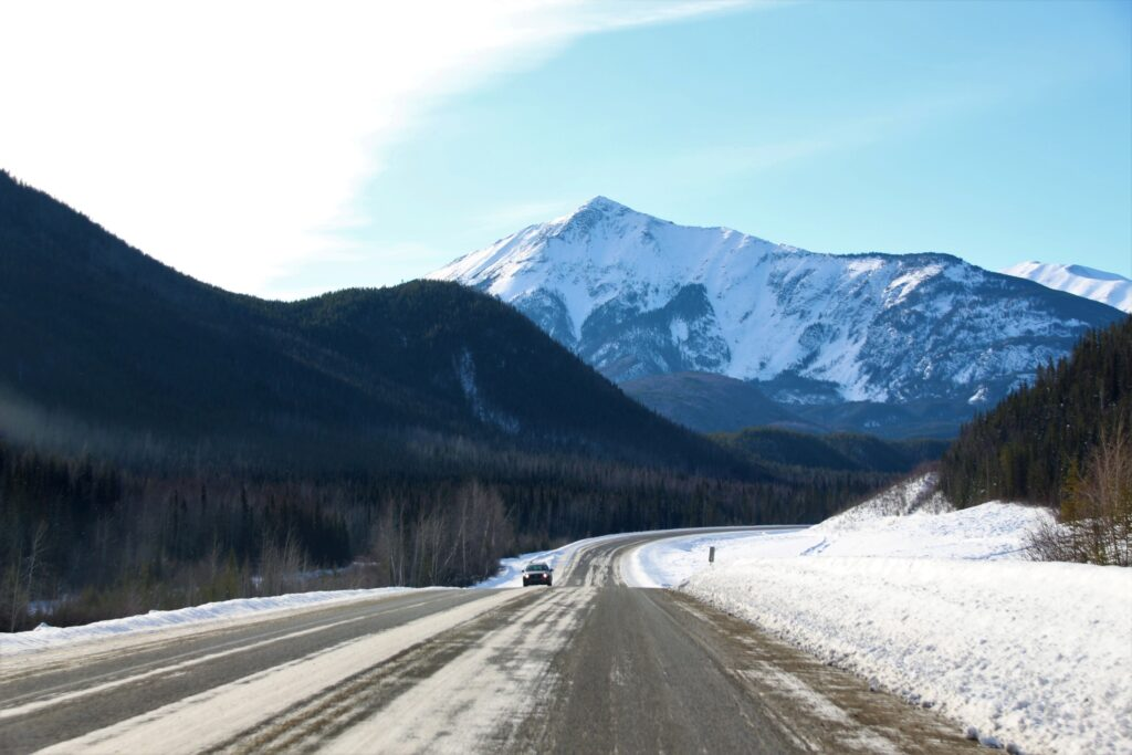 Scenic view of Alaska Highway winding through the valley