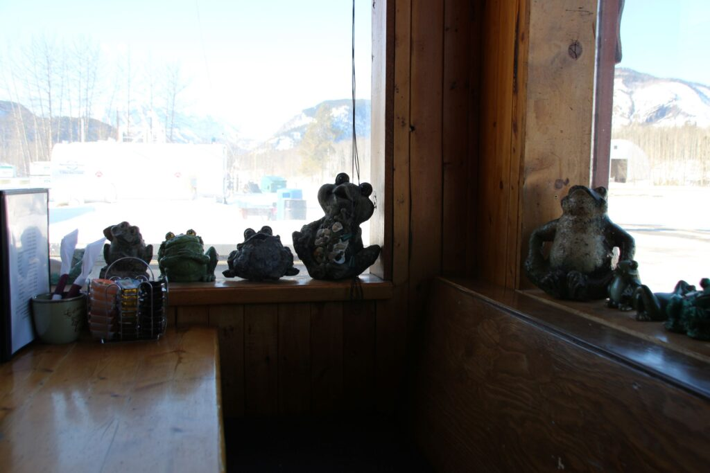 Mini toad sculptures by the window