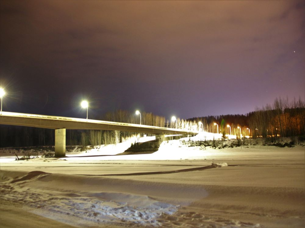 Night photo of the bridge over Muskwa River at Fort Nelson