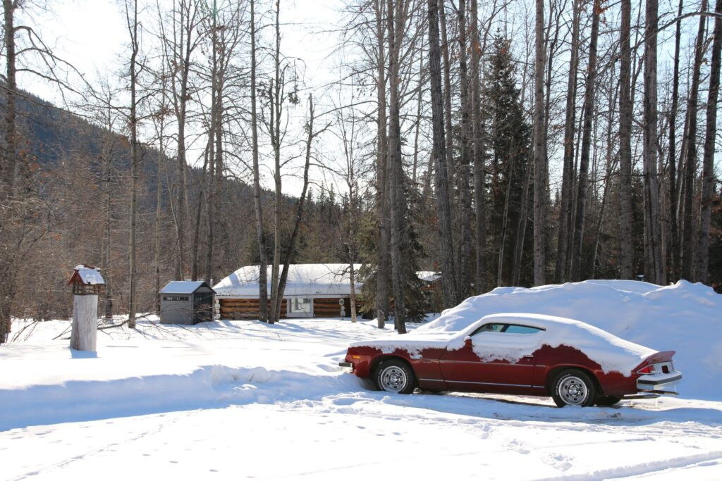 parking lot with a red car at Tetsa River Campground