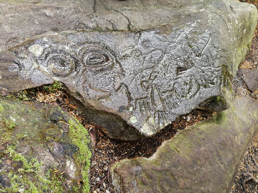 The creation story of Nuxalk People recorded in the petroglyphs that have ravens, sun, and wisemen