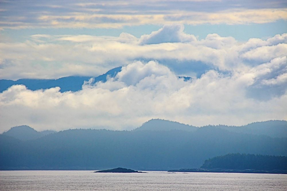 dramatic clouds at Namu with island and mountains as backdrop