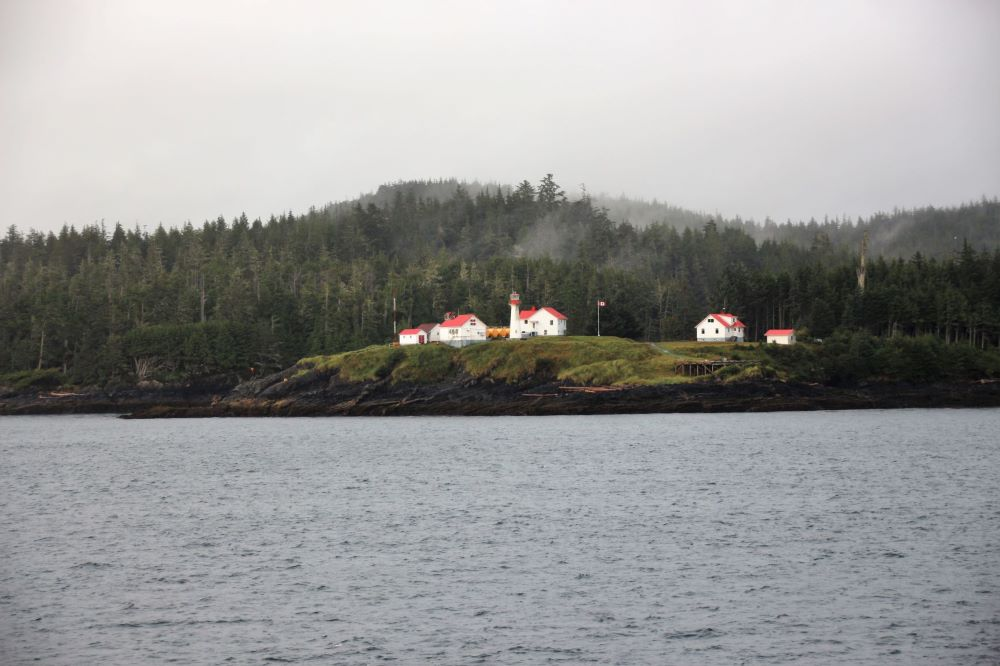 Beautiful red roof & white buildings of Scarlett Point Lighthouse